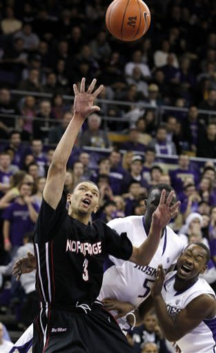 Cal State Northridge's Stephan Hicks (3) shoots in front of Washington's Aziz N'Diaye (5) and Terrence Ross, right, in the first half of an NCAA college basketball game on Thursday, Dec. 22, 2011, in Seattle. (AP Photo/Elaine Thompson)
