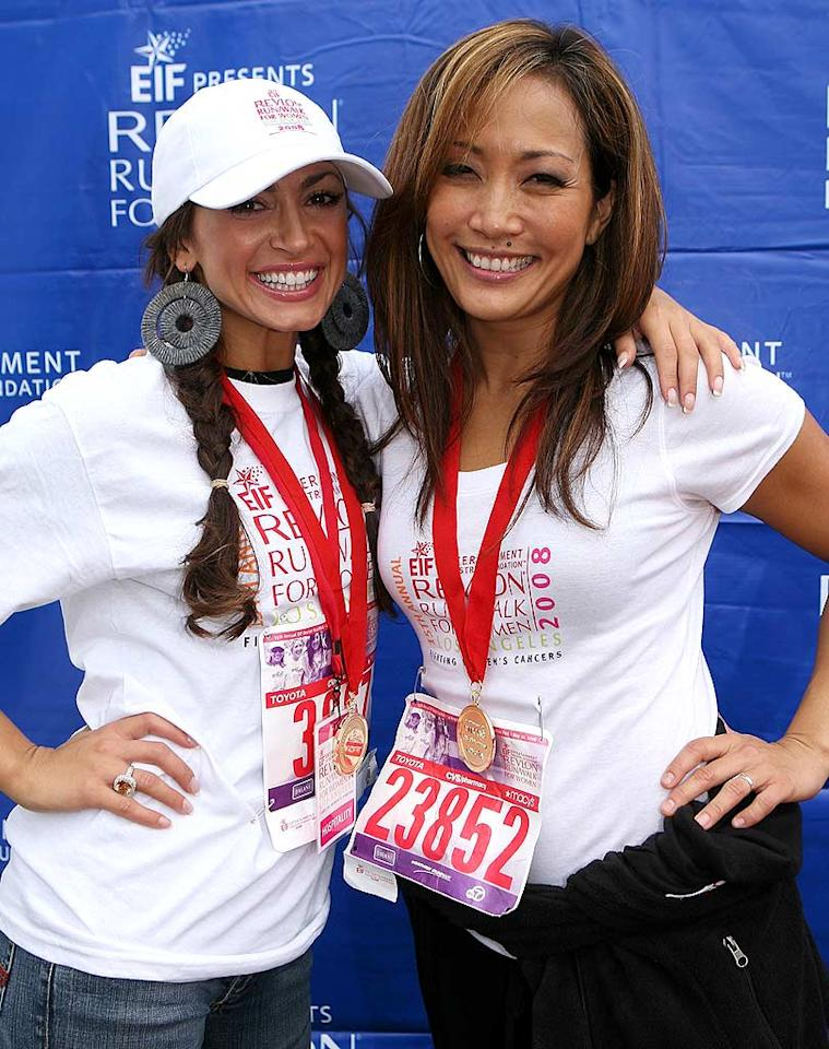 "Dancer Karina Smirnoff and Carrie Ann proudly pose with their medals after crossing the finish line. Chris Weeks/<a href=""http://www.wireimage.com"" target=""new"">WireImage.com</a> - May 10, 2008"