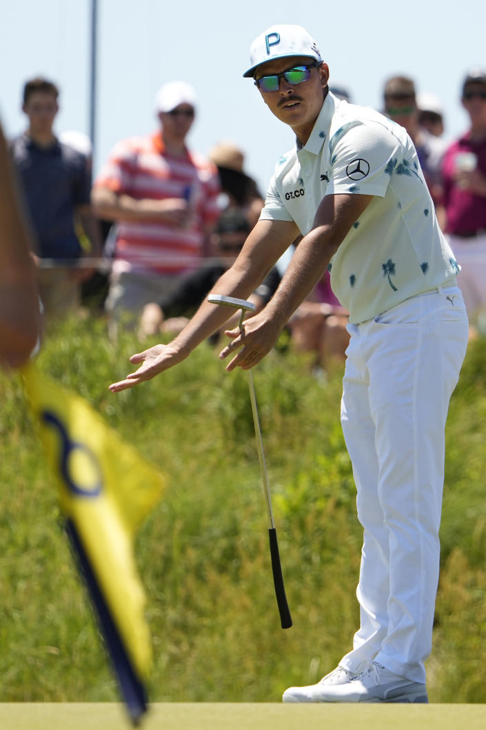 Rickie Fowler reacts as he misses a birdie putt on the eighth hole during the first round of the PGA Championship golf tournament on the Ocean Course Thursday, May 20, 2021, in Kiawah Island, S.C. (AP Photo/David J. Phillip)