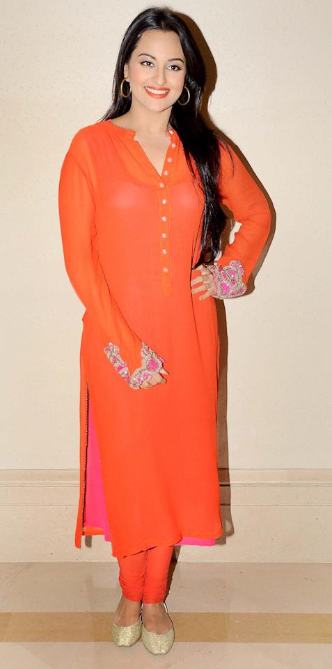 Ravishing in this straight orange with undertones of pink kurta and chooridaar is Sonakshi Sinha. What a perfect look for a menhendi.