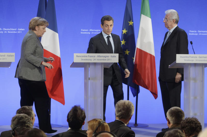 German Chancellor Angela Merkel, left, France's President Nicolas Sarkozy, center, and Italy's Prime Minister Mario Monti, right, during a press conference in Strasbourg, eastern France, Thursday, Nov 24, 2011.  The leaders of Germany, France and Italy are set for debate on the European Central Bank's role in the region's debt crisis and on how to align eurozone economic policies. (AP Photo/Michel Euler, Pool)