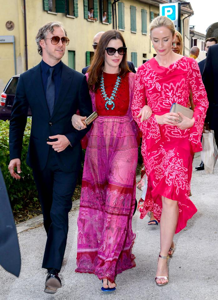 <p>For the wedding of their actress friend Jessica Chastain, Anne Hathaway and Emily Blunt were almost matching in vibrant pink and purple creations.<br /><em>[Photo: Rex]</em> </p>