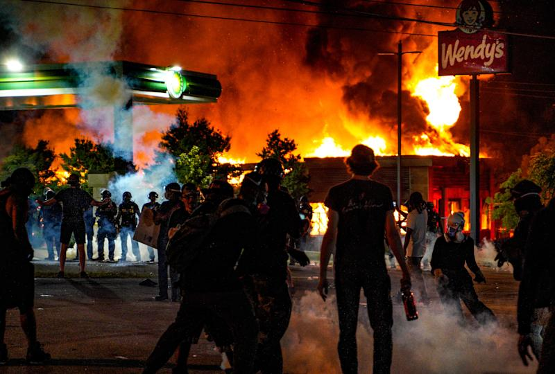 ATLANTA, USA - JUNE 13: Demonstrators set on fire a restaurant during the protest after an Atlanta police officer shot and killed Rayshard Brooks, 27, at a Wendy's fast food restaurant drive-thru Friday night in Atlanta, United States on June 13, 2020. As nationwide protests slowed in the death of George Floyd, anger again erupted Saturday in the US over the fatal shooting of another black man. Mayor Keisha Lance Bottoms announced Atlanta Police Chief Ericka Shields voluntarily stepped down from the department earlier in the day. (Photo by Ben Hendren/Anadolu Agency via Getty Images)