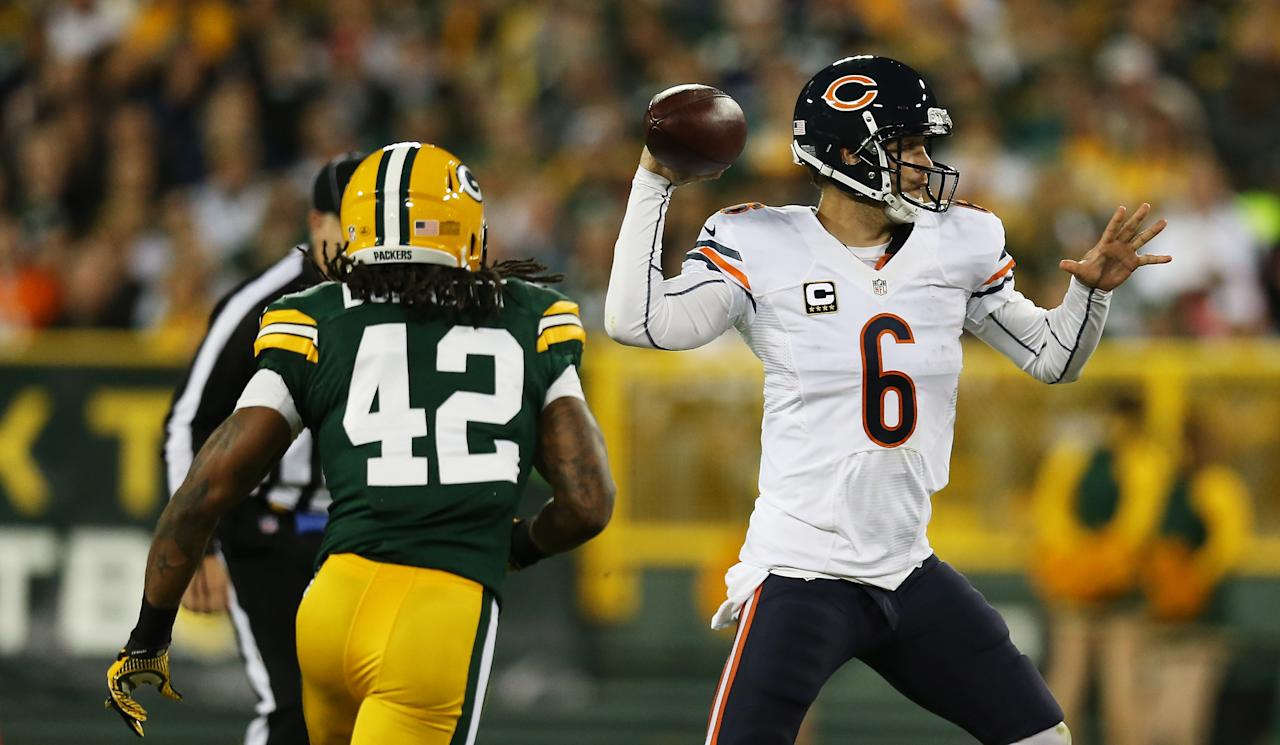 GREEN BAY, WI - SEPTEMBER 13:  Quarterback Jay Cutler #6 of the Chicago Bears looks turnover pass under pressure from free safety Morgan Burnett #42 of the Green Bay Packers in the second quarter at Lambeau Field on September 13, 2012 in Green Bay, Wisconsin.  (Photo by Jonathan Daniel/Getty Images)