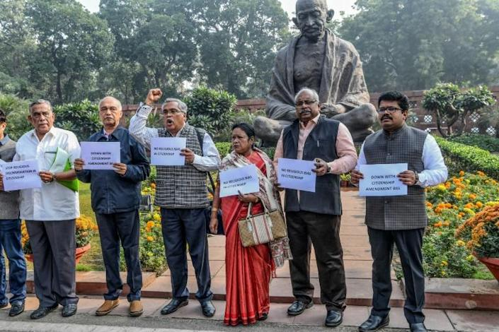 Indian MPs protest against the bill which the opposition and rights groups say fits into Prime Minister Narendra Modi's Hindu nationalist agenda (AFP Photo/Prakash SINGH)