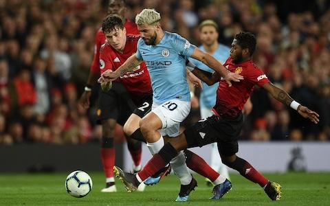 Sergio Aguero, Victor Lindelof and Fred battle for the ball - Credit: afp