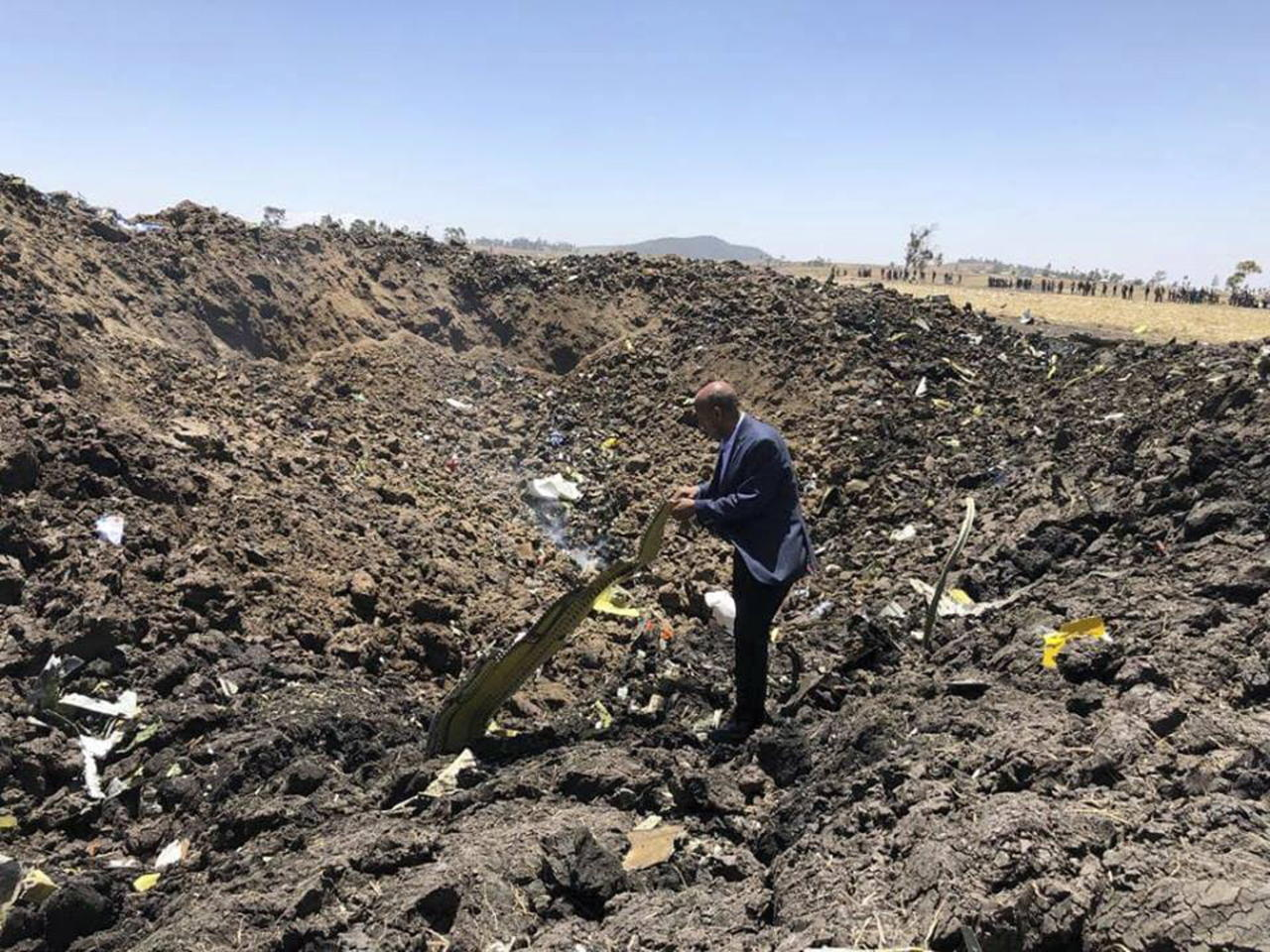 <p>In this photo taken from the Ethiopian Airlines Facebook page, the CEO of Ethiopian Airlines, Tewolde Gebremariam, looks at the wreckage of the plane that crashed shortly after takeoff from Addis Ababa, Ethiopia. (Facebook via AP/The Canadian Press) </p>