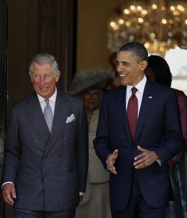 U.S. President Obama walks with Prince Charles in London