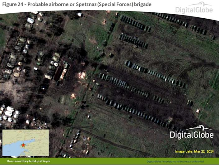 This satellite image made by DigitalGlobe on March 22, 2014, and provided by Supreme Headquarters Allied Powers Europe (SHAPE) on Tuesday, April 9, 2014, shows what is purported to be a Russian military airborne or Spetznaz (Special Forces) brigade at Yeysk, near the Sea of Azov in southern Russia. The image is one of several provided to the AP by NATO's headquarters that show dozens of Russian tanks and other armored vehicles, combat jets and helicopter gunships stationed inside Russian territory near to the eastern border with Ukraine. AP cannot independently verify the authenticity or content of this image. (AP Photo/DigitalGlobe via SHAPE) MANDATORY CREDIT, NO CROPPING OR MODIFICATIONS ALLOWED