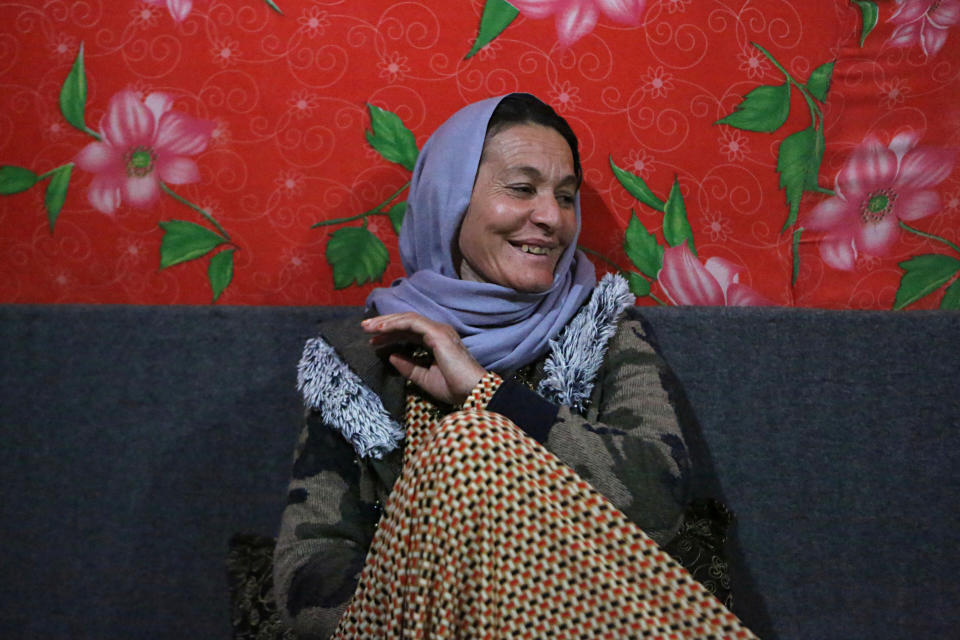 In this Thursday, Feb. 28, 2019 photo, Baseh Hammo, a Yazidi woman who escaped enslavement by Islamic State group militants, sits in a relatives's tent at a camp for displaced people outside Dahuk, Iraq. Yazidi women enslaved by IS who escaped captivity say there could be hundreds of other women still missing, women who may never return home. They say they fear many perished in bondage or war while others chose to remain in captivity to stay with the children they were forced to have. (AP Photo/Khalid Mohammed)