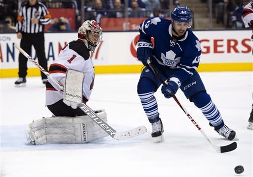 New Jersey Devils goaltender Johan Hedberg (1) defends against Toronto Maple Leafs center Nazem Kadri (43) during the second period of their NHL hockey game, Monday, March 4, 2013, in Toronto. (AP Photo/The Canadian Press, Frank Gunn)