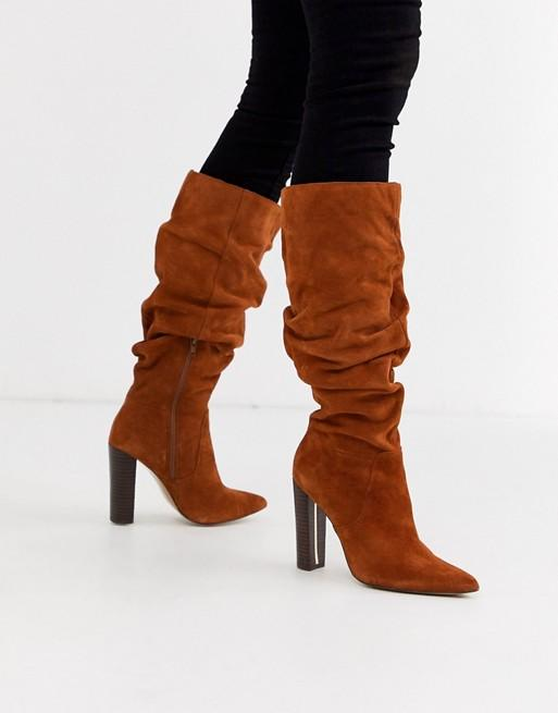 River Island slouchy knee high boots. Image via ASOS.
