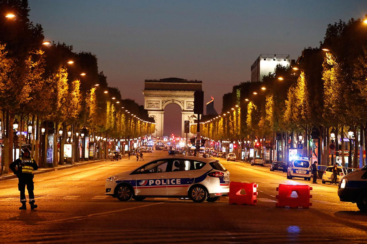 <p>Police secure the Champs Elysee Avenue after one policeman was killed and another wounded in a shooting incident in Paris, France, April 20, 2017. (Christian Hartmann/Reuters) </p>