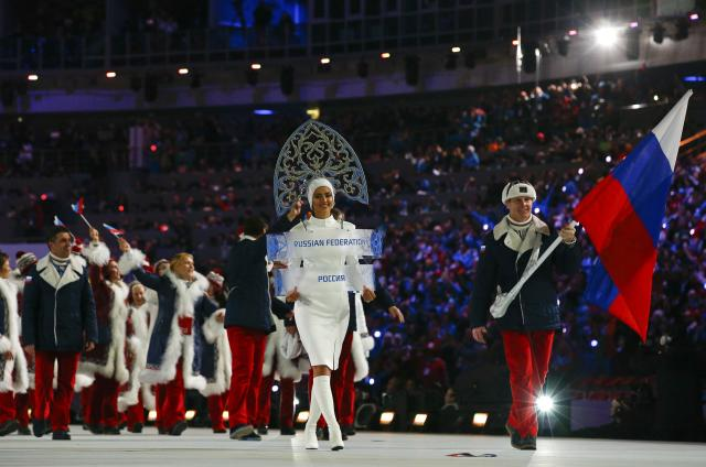 Russia's flag-bearer Alexander Zubkov leads his country's contingent during the opening ceremony of the 2014 Sochi Winter Olympic Games at Fisht stadium February 7, 2014. REUTERS/Brian Snyder (RUSSIA - Tags: OLYMPICS SPORT)