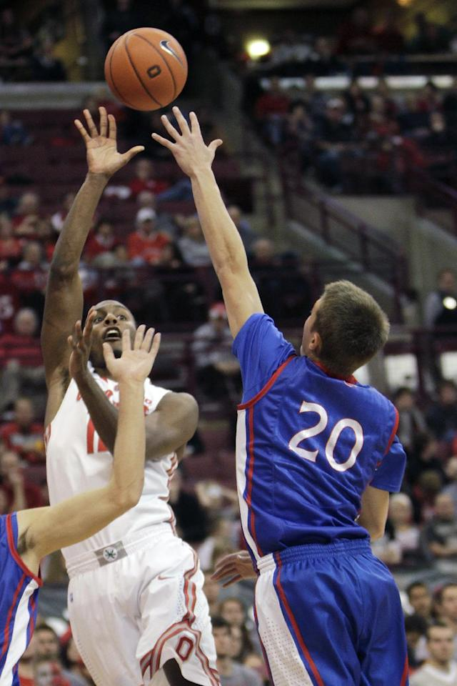 Ohio State's Sam Thompson, left, shoots over American's Charlie Jones during the second half of an NCAA college basketball game Wednesday, Nov. 20, 2013, in Columbus, Ohio. (AP Photo/Jay LaPrete)