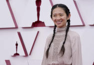 Chloe Zhao arrives at the Oscars on Sunday, April 25, 2021, at Union Station in Los Angeles. (AP Photo/Chris Pizzello, Pool)