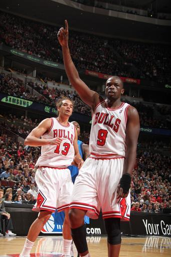 CHICAGO, IL - APRIL 21: Luol Deng #9 of the Chicago Bulls celebrates with teammate Joakim Noah #13 during a game against the Dallas Mavericks on April 21, 2012 at the United Center in Chicago, Illinois. (Photo by Nathaniel S. Butler/NBAE via Getty Images)