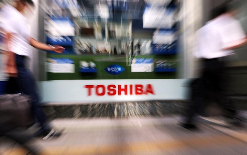 Toshiba's sharp share rise came after a report spelling out the firm's wrongdoings, easing a sense of uncertainty after the firm withdrew in May its earnings forecasts (AFP Photo/Yoshikazu Tsuno )