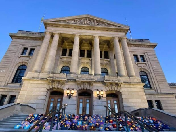 Approximately 150 backpacks on the steps of the Saskatchewan legislature on June 28, 2021. Organizers hope to gather enough to display 751 backpacks, one for each of the unmarked graves discovered at the former Marieval Indian Residential School, by Canada Day.  (Prairie Crowe/Submitted - image credit)