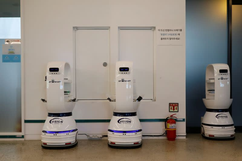 Robots that take orders, make coffee and bring the drinks straight to customers are charged in a cafe Daejeon