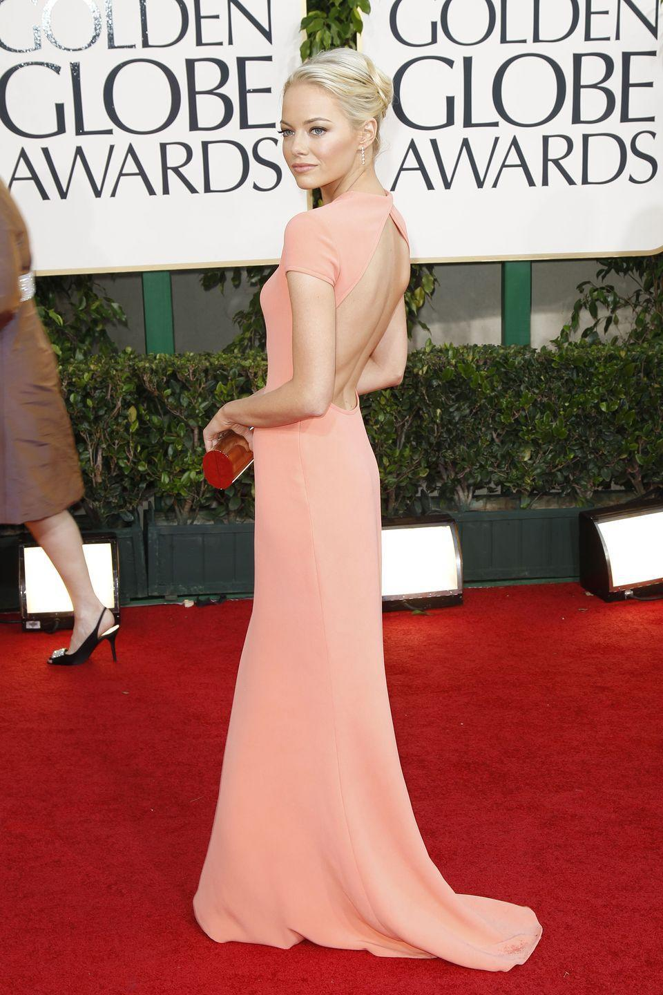 <p>The young starlet proved herself to be a style icon in the making in 2011 with this figure-flattering Calvin Klein Collection gown.</p>