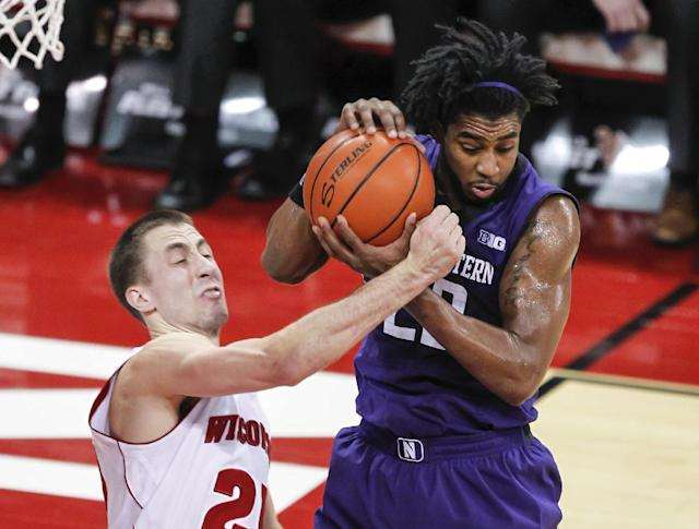 Northwestern's JerShon Cobb, right, gets a defensive rebound away from Wisconsin's Josh Gasser during the first half of an NCAA college basketball game Wednesday, Jan. 29, 2014, in Madison, Wis. (AP Photo/Andy Manis)