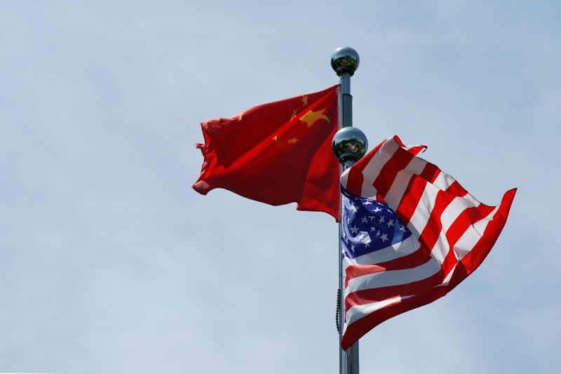 Chinese and U.S. flags flutter near The Bund in Shanghai