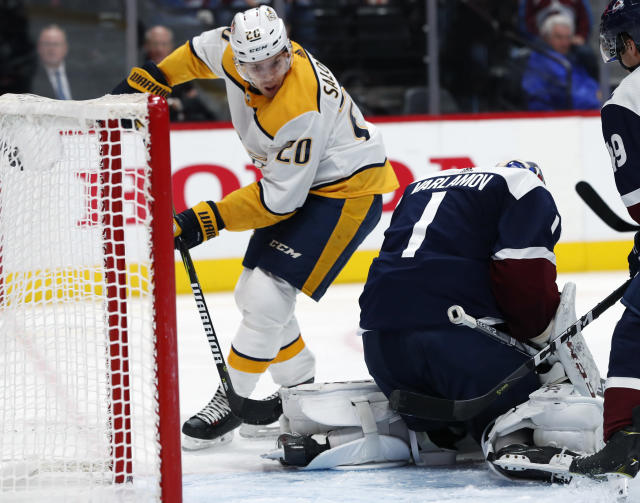 Nashville Predators right wing Miikka Salomaki, left, has his shot stopped by Colorado Avalanche goaltender Semyon Varlamov during the second period of an NHL hockey game Wednesday, Nov. 7, 2018, in Denver. (AP Photo/David Zalubowski)