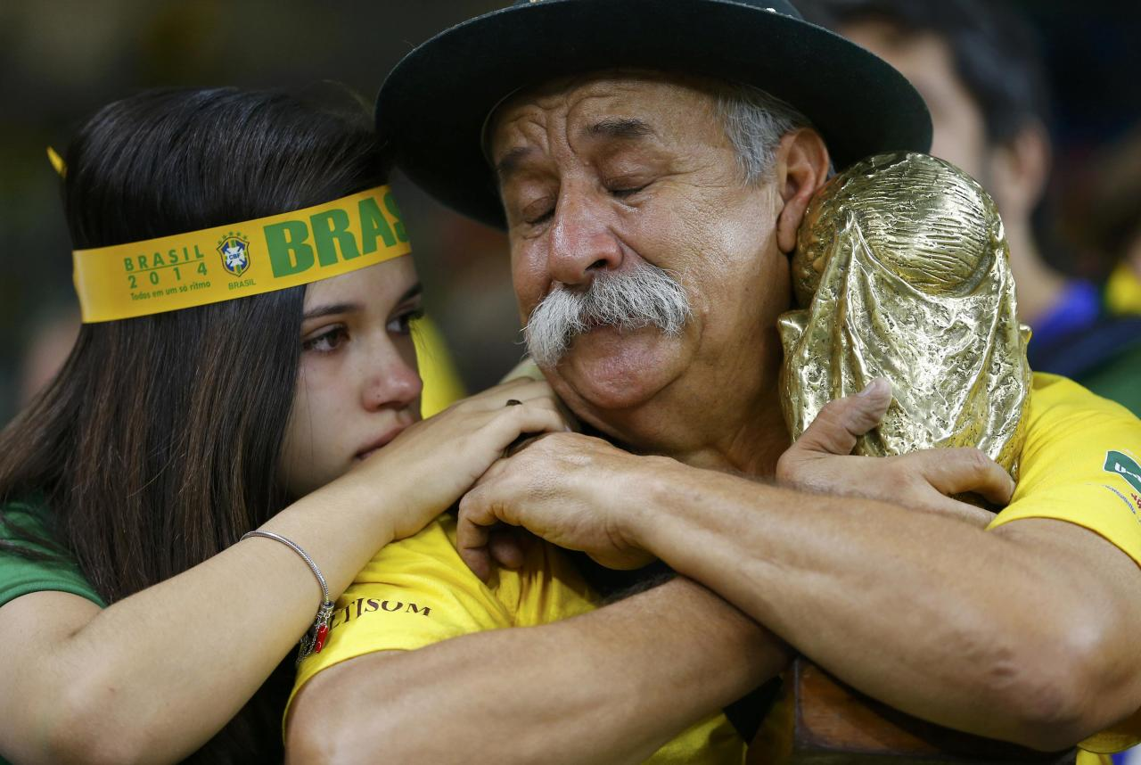Brazilian fans react to their team's loss at the end of their 2014 World Cup semi-finals against Germany at the Mineirao stadium in Belo Horizonte July 8, 2014. REUTERS/Damir Sagolj (BRAZIL - Tags: SOCCER SPORT WORLD CUP TPX IMAGES OF THE DAY)