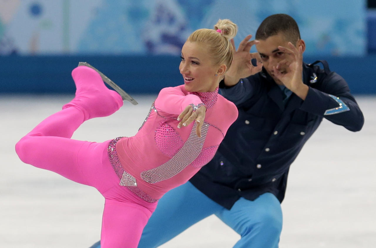 Aliona Savchenko and Robin Szolkowy of Germany compete in the pairs short program figure skating competition at the Iceberg Skating Palace during the 2014 Winter Olympics, Tuesday, Feb. 11, 2014, in Sochi, Russia. (AP Photo/Ivan Sekretarev)
