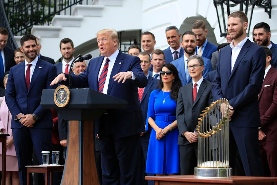 President Donald Trump flanked by Red Sox players Chris Sale, right, and J. D. Martinez, left, speaks during a ceremony welcoming the 2018 World Series baseball champions to the White House, the Boston Red Sox to the White House in Washington, Thursday, May 9, 2019. (AP Photo/Manuel Balce Ceneta)