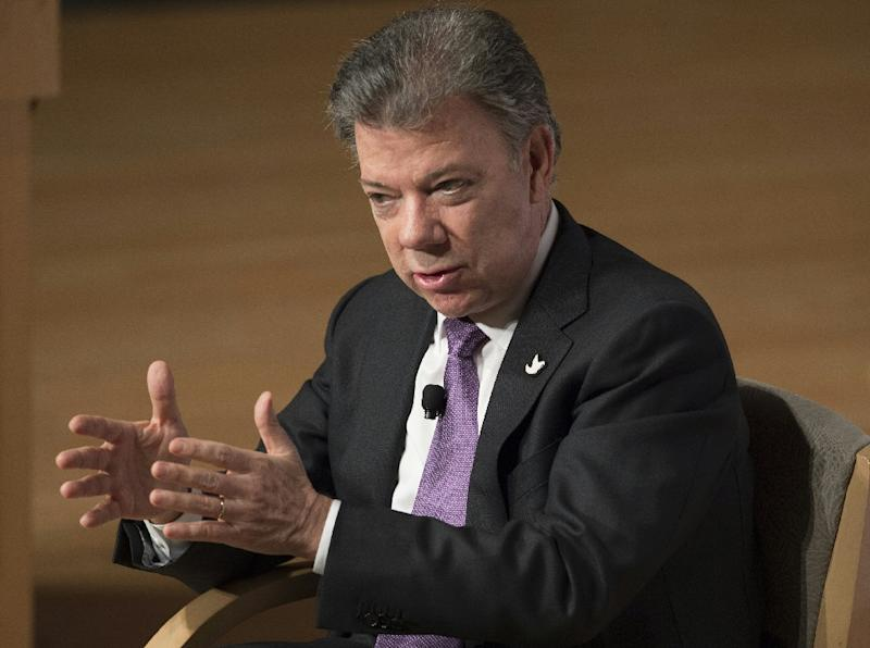 Colombian President Juan Manuel Santos speaks about the current situation in Colombia at the Ronald Reagan Building in Washington, DC, February 3, 2016 (AFP Photo/Saul Loeb)
