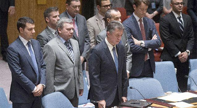 Ukrainian U.N. Ambassador Yuriy Sergeyev, centre, stands for a moment of silence for the lives lost on Malaysia Airlines Flight 17 on Thursday during a meeting at United Nations headquarters on Friday. Photo: AP/John Minchillo.