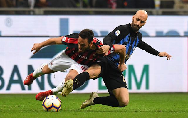 "Inter <a class=""link rapid-noclick-resp"" href=""/soccer/teams/milan/"" data-ylk=""slk:Milan"">Milan</a>'s Borja Valero, right, battles with AC Milan's Hakan Calhanoglu of AC Milan on Sunday at the San Siro. (Getty)"
