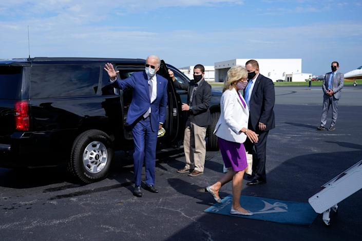 Democratic presidential nominee Joe Biden and his wife, Jill, board a plane at New Castle Airport in Delaware on Sept. 3 to visit Kenosha, Wis.