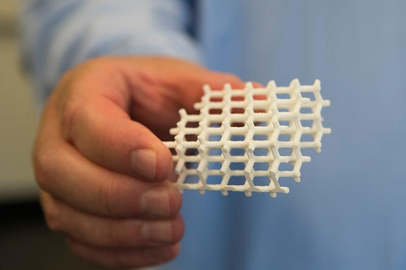 Professors and researchers at the University of Delaware are fabricating a baseball-sized ceramic lens that they hope will become a key component in the future of the internet.