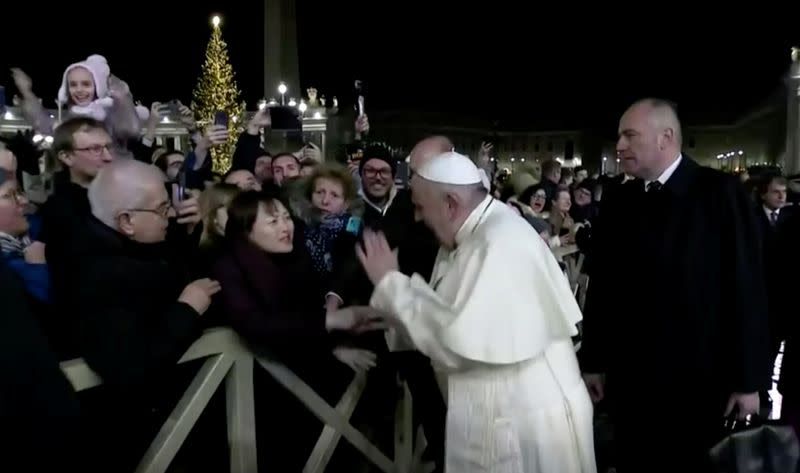 Pope Francis slaps the hand of a woman who grabbed him, at Saint Peter's Square at the Vatican