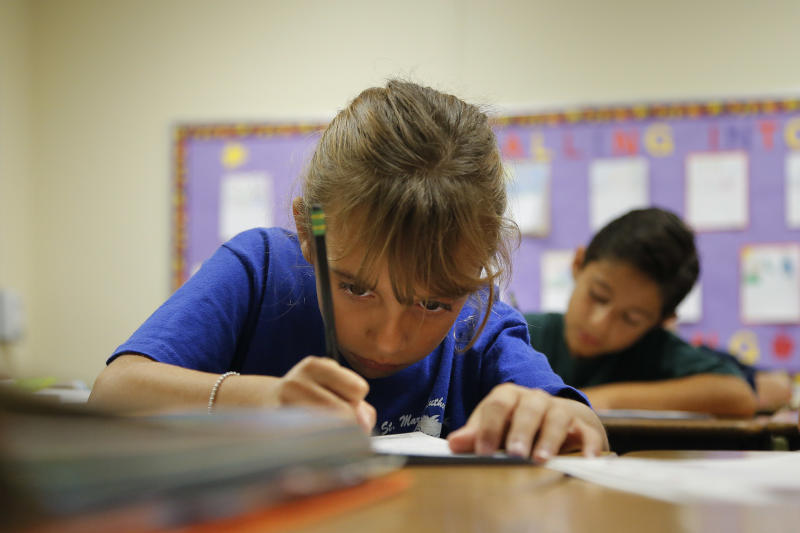 Alexia Herrera practices writing in cursive at St. Mark's Lutheran School in Hacienda Heights, Calif., Thursday, Oct. 18, 2012. Bucking a growing trend of eliminating cursive from elementary school curriculums or making it optional, California is among the states keeping longhand as a third-grade staple.  (AP Photo/Jae C. Hong)