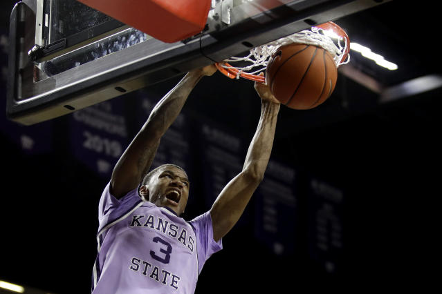 Kansas State's DaJuan Gordon dunks the ball during the second half of an NCAA college basketball game against West Virginia Saturday, Jan. 18, 2020 in Lawrence, Kan. Kansas State won 84-68. (AP Photo/Charlie Riedel)