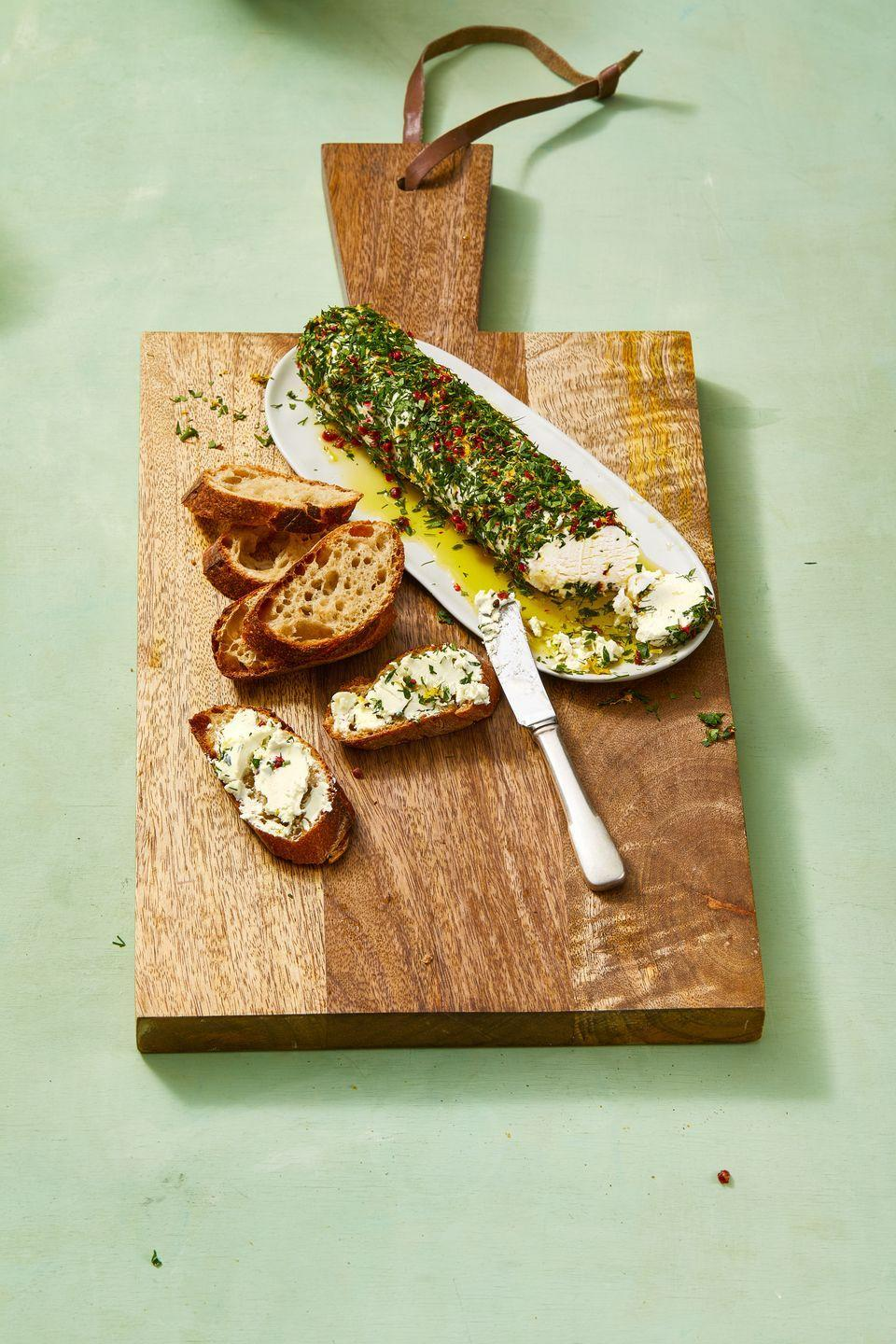 """<p>Roll a goat cheese log in fresh herbs, lemon zest and peppercorns for the easiest-ever appetizer that looks super fancy.</p><p><em><a href=""""https://www.goodhousekeeping.com/food-recipes/easy/a30655780/goat-cheese-appetizer-recipe/"""" rel=""""nofollow noopener"""" target=""""_blank"""" data-ylk=""""slk:Get the recipe for Lemon-Herb Goat Cheese Log »"""" class=""""link rapid-noclick-resp"""">Get the recipe for Lemon-Herb Goat Cheese Log »</a></em></p><p><strong>RELATED: </strong><a href=""""https://www.goodhousekeeping.com/food-recipes/easy/g122/easy-appetizers/"""" rel=""""nofollow noopener"""" target=""""_blank"""" data-ylk=""""slk:51 Easy Appetizers and Snacks to Get the Party Started"""" class=""""link rapid-noclick-resp"""">51 Easy Appetizers and Snacks to Get the Party Started</a><br></p>"""