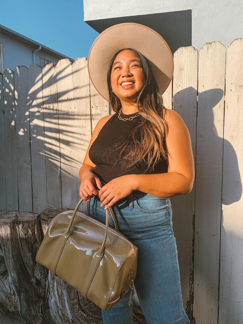"<div class=""caption""> This LNA tank top and Madewell jeans combo is something I would wear every day. </div> <cite class=""credit"">Kristin Corpuz</cite>"