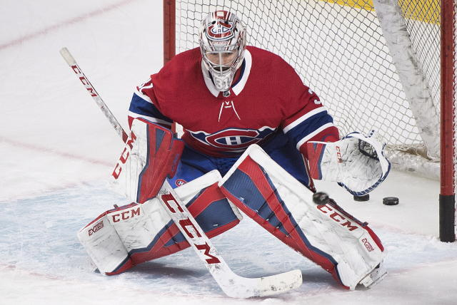 Montreal Canadiens goaltender Carey Price makes a save during warmups prior to an NHL hockey game against the Florida Panthers in Montreal, Monday, March 19, 2018. (Graham Hughes/The Canadian Press via AP)