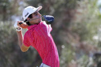 Joaquin Niemann, of Chile, drives off the first tee during the third round at the Sony Open golf tournament Saturday, Jan. 16, 2021, in Honolulu. (AP Photo/Marco Garcia)