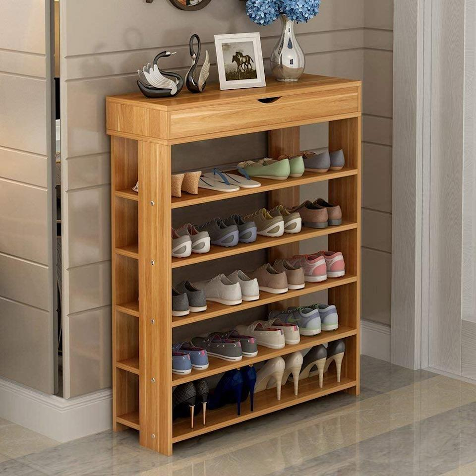 <p>If you and your roommate have a lot of shoes, the <span>Soges Wooden Shoe Storage Shelf</span> ($69) is a must to stay organized. In fact, you can use this to store other necessities like snacks and drinks, clothes and linens, and a dedicated spot for your shower caddies,</p>