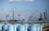 FILE PHOTO: The reactor units 1 to 4 are seen over storage tanks for radioactive water are seen at tsunami-crippled Fukushima Daiichi nuclear power plant in Okuma town, Fukushima prefecture