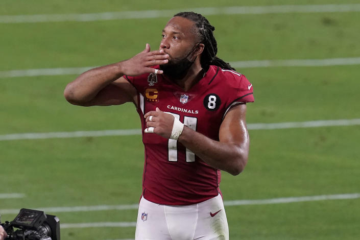 Arizona Cardinals wide receiver Larry Fitzgerald (11) blows a kiss as he leaves the field after an NFL football game against the San Francisco 49ers, Saturday, Dec. 26, 2020, in Glendale, Ariz. The 49ers won 20-12. (AP Photo/Ross D. Franklin)