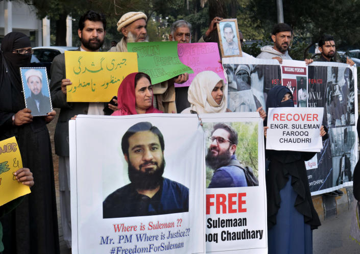 Pakistani families hold pictures of their missing family members during a demonstration to mark World Human Rights Day in Islamabad, Pakistan, Tuesday, Dec. 10, 2019. Dozens of Pakistanis whose relatives were allegedly detained by security agencies in recent years Tuesday urged prime minister Imran Khan Khan to immediately order the release of their loved ones, as activists observed Human Rights Day across the country. (AP Photo/A.H. Chaudary)