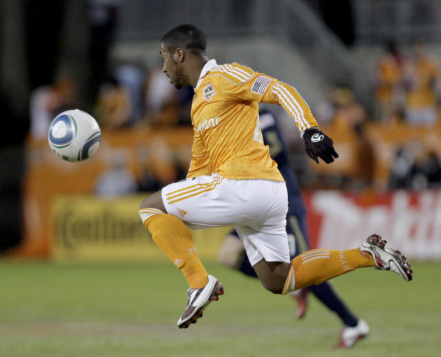HOUSTON, TX - NOVEMBER 03: Corey Ashe #26 of the Houston Dynamo attacks the ball against the Philadelphia Union in the second leg of the playoffs on November 3, 2011 at Robertson Stadium in Houston, Texas. The Dynamo won 1 to 0 and will play the Sporting K.C. Sunday, November 6, 2011. (Photo by Thomas B. Shea/Getty Images)