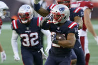 New England Patriots defensive back Adrian Phillips, center, celebrates his interception of a pass by Arizona Cardinals quarterback Kyler Murray in the second half of an NFL football game, Sunday, Nov. 29, 2020, in Foxborough, Mass. (AP Photo/Elise Amendola)
