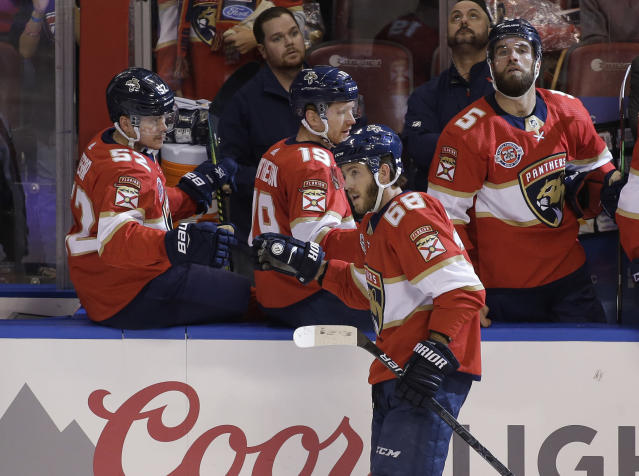 Florida Panthers left wing Mike Hoffman (68) celebrates with teammates after scoring a goal against the Arizona Coyotes during the second period of an NHL hockey game on Thursday, March 21, 2019, in Sunrise, Fla. (AP Photo/Terry Renna)